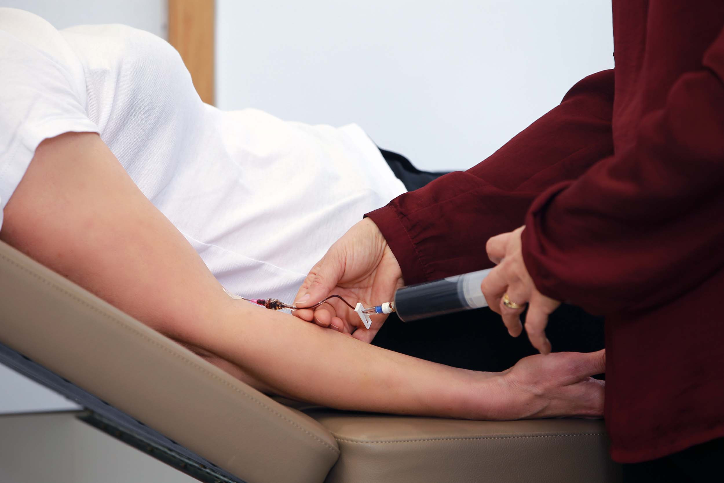Patient receiving iron infusion at Auckland Doctors Clinic.